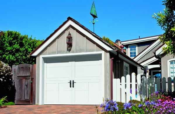 "alt=""Amarr Carriage house garage door in oak installed by five Star Doors for a customer in Novi Michigan."""